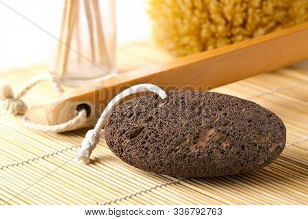 Black Lava Pumice Stone With Natural Spa Or Bath Utensils Used For Peeling Or Callused Skin Removal