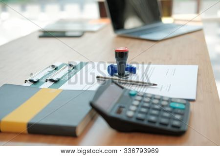 Stamper Insurance Contract Document On Lawyer Broker Realtor Real Estate Agent Desk