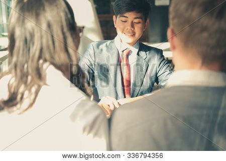 Couple Consulting Lawyer About Buying Renting House Car. Insurance Broker Financial Advisor Giving L