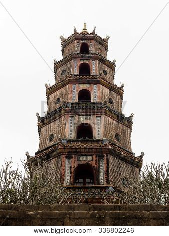 Hue, Vietnam - March 12, 2016: Historic Thien Mu Pagoda On The Banks Of Perfume River Near Hue