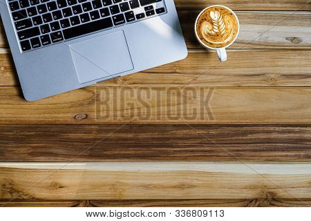 Office Desk Table Of Modern Workplace With Laptop On Wooden Table, Top View Laptop Background And Co