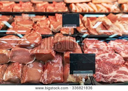Pieces Of Fresh Chilled Beef On The Counter Under The Glass, Selection Of Quality Meat At A Butcher