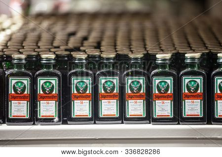 Vienna, Austria - November 6, 2019: Jagermeister Label On Many Rows Of Bottles In A Shop Of Vienna.