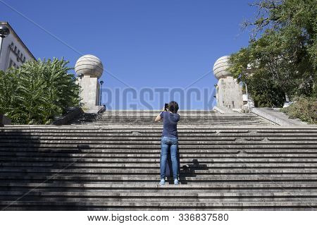 Young Tourist Woman Taking Pictures From Coimbra Monumental Stairs. Famous Spot Where Students Love