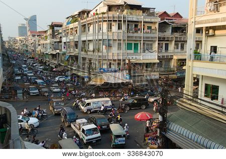 Phnom Penh, Cambodia - March, 2015: Traffic Jam On A Road Intersection. Stuck In A Traffic With Crow