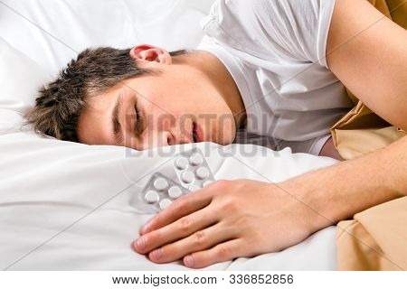 Sick Young Man Sleep With A Pills In The Bed At The Home