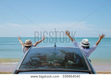 Summer Vacation And Car Trip Concept : Family Car Trip At The Sea, Woman And Child Cheerful Raising
