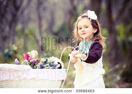 Pretty young girl with spring flowers