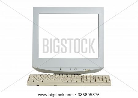 Old Retro Crt Monitor Display With Blank White Screen And A Keyboard Isolated On White Background.