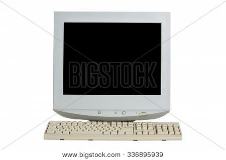 Old Retro Crt Monitor Display With A Keyboard Isolated On White Background.
