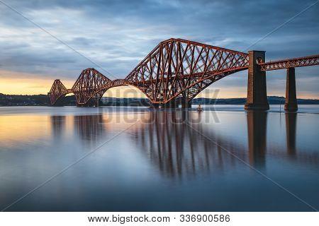 View Of Forth Rail Bridge, The Worlds Longest Cantilever Bridge, At Sunset On Long Exposure, Scotlan