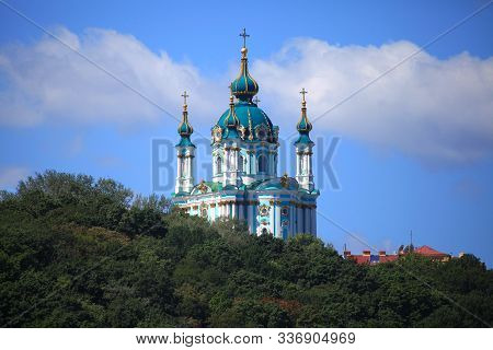 Kiev, Ukraine – July 30, 2017: Saint Andrew's Church On Kiev's Green Hills Background. The Church In