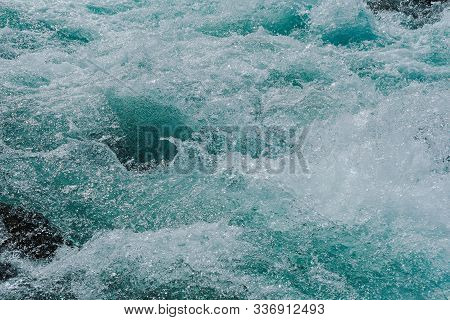 Blue Bubbling Water Of Mountain River. Ocean Tide Of  Turquoise Sea