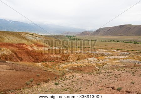 Colored Hills In Mountain Valley. Dry Sandy Red Hills On Hot Summer Day. Drought, Climate Change. So