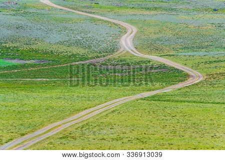 Dirt Road In Autumn Field. Travel Through Countryside Off Road