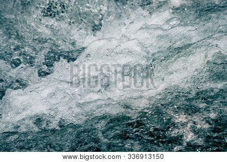 Water Surface Of Ocean, Sea Tide. Rapid Flow Of River