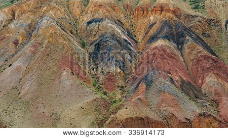 Colored Hills, Stripes Of Different Colors On Slope Of Canyon. Dry Land Due To Lack Of Water. Drough