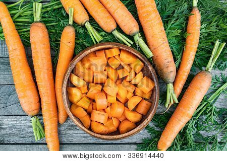 Fresh Carrots On Wooden Table After Harvesting, Cooking For Vegetarians, Healthy Food. Growing Veget