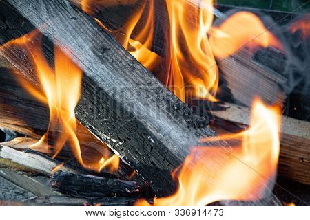 Flames Of Fire Rise Above Coals. Campfire For Outdoor Recreation, Barbecue