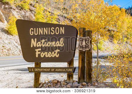 Gunnison, Co - October 3, 2019: Gunnison National Forest Welcome Sign Along The Road In Autumn