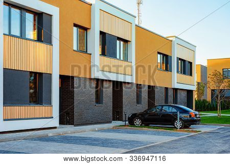 Apartment Modern Townhouse Residential Building And Car Parked