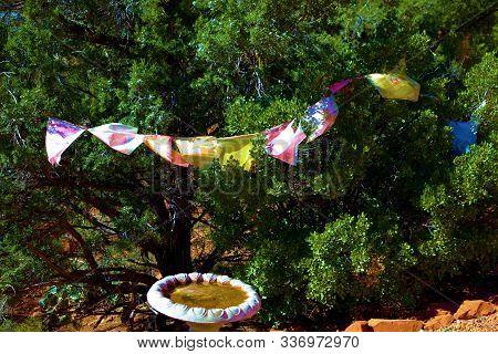 October 17, 2019 In Sedona, Az: Tibetan Prayer Flags Hanging Over A Wishing Well Taken At The Amitab