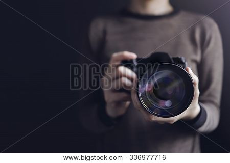 Photographer Taking Self-portrait. Woman Using Camera To Taking Photo. Dark Tone, Front View. Select