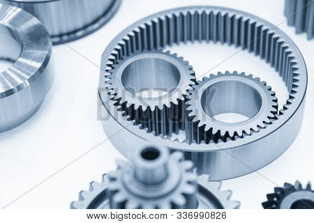 The Close-up Scene Of Planetary Gear Parts Of  Automatic Transmission Gear Box  In The Light Blue Sc