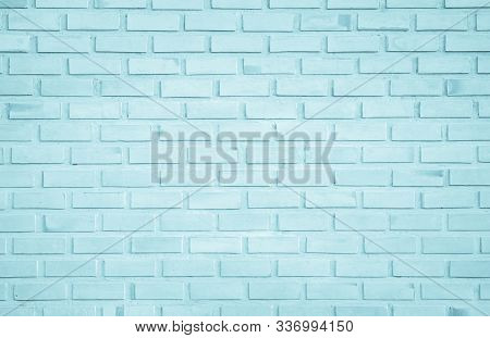 Brick Wall Painted With Pale Blue Paint Pastel Calm Tone Texture Background. Brickwork And Stonework