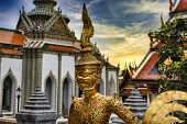 Beautifully stunning gold statue of a Kinnara, a beloved mythical half-human, half-bird creature on the Upper Terrace of Wat Phra Kaew or Temple of the Emerald Buddha in the Grand Palace of Bangkok poster