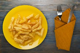 French Fries On A Yellow Plate On A Blue Wooden Background.fast Food Top View.junk Food