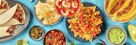 Mexican Food Panoramic Top-down Shot. Nachos, Quesadillas, Shrimp Cocktail, Chili Con Carne, Taco Sh