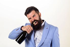 Sexy Male Model Pulls Out Cork With Teeth With Bottle Of Wine. Brutal Handsome Man Opens His Teeth B