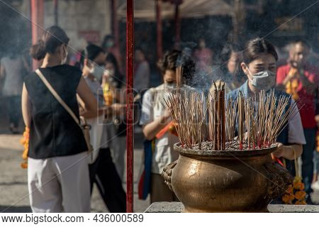 Bangkok, Thailand - 16 Feb 2020 : Incense Burning With White Smoke In An Incense Pot At A Temple In