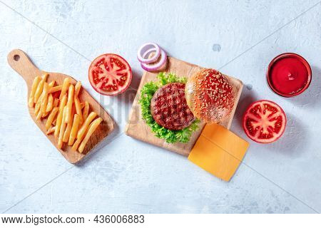 Burger Ingredients, Overhead Flat Lay Shot. Hamburger Patty Steak, French Fries, Vegetables And Ketc