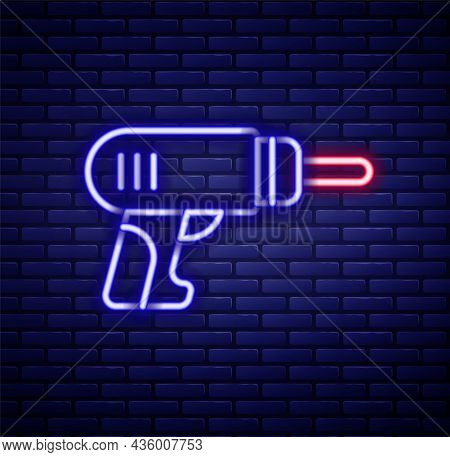 Glowing Neon Line Electric Drill Machine Icon Isolated On Brick Wall Background. Repair Tool. Colorf