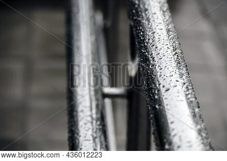 Background With Wet Metal Chrome Railings Covered With Raindrops. Abstract Background. The Concept O