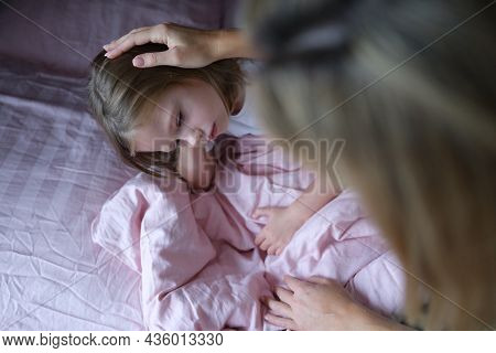 Mom Puts Sad Girl On Head Before Going To Bed.