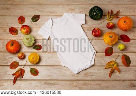 White Baby Short Sleeve Bodysuit Mockup With Fall Decor