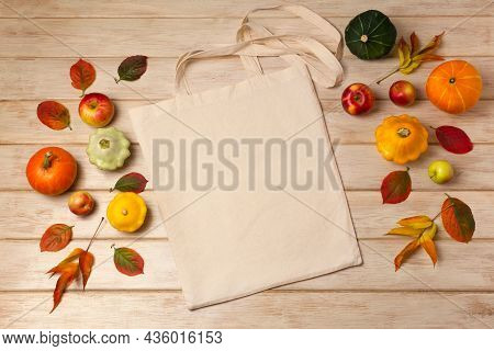 Rustic Tote Bag Mockup With Pumpkins And Fall Leaves