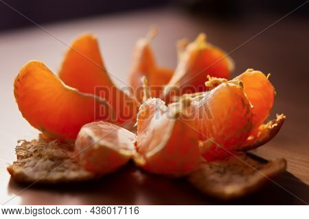 Mandarin Macro Background. Orange Slices Are Sweet Appetizing Close-up In Natural Light. Selective F