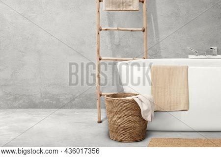 Japandi bathroom interior design with wooden furniture