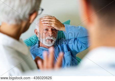 Doctor Discusses The Diagnosis With The Worried Senior Man Patient. Healthcare Concept