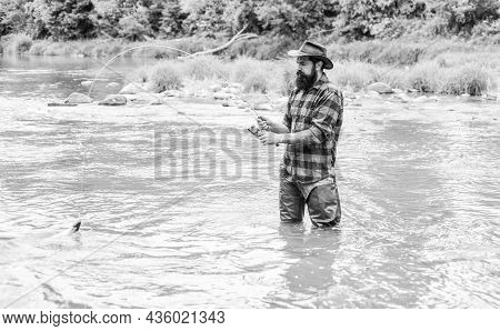 Your Favourite Hobby. Bearded Fisher In Water. Hobby And Sport Activity. Fisherman Show Fishing Tech