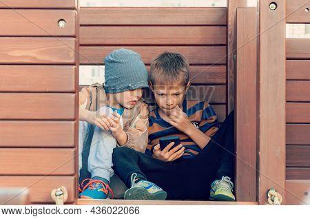Krasnodar, Russia - October 9 2021: Boys Spending Time In A Social Network Using Mobile Phones.
