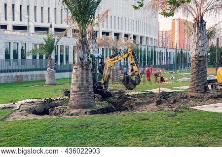 Krasnodar, Russia - October 12 2021: Mini Excavator In The Park Near The Stadium. Minibagger At Work