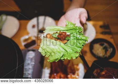 Korean Grilled Pork With Vegetable Wrap Korean Style, Korean Barbeque Dish, Served With Fresh Lettuc
