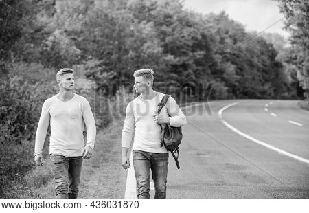 Type Of Travel. Men Hitch Hiking. Man Casual Style Travel With Backpack. Traveler Hitchhiking On Hig
