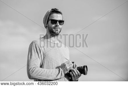 Adding Moments Of Life. Macho Man With Camera. Travel With Camera. Male Fashion Style. Looking Trend