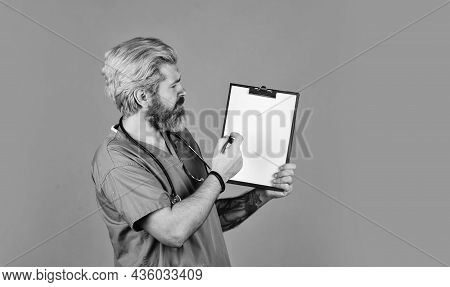 Helping You Live Longer. Doctor With Stethoscope And Clipboard. Therapist Writing Prescription. Medi
